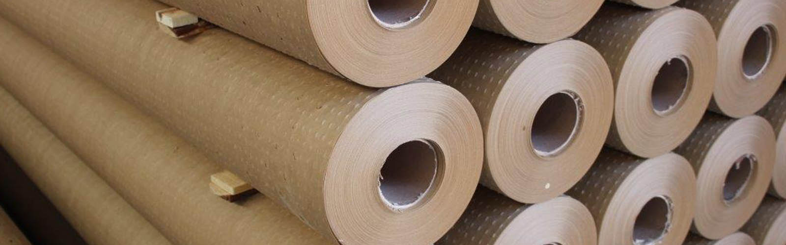 Rolls of cutting paper for fabric cutting machines